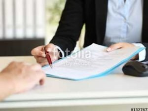 Attorney Presenting Papers to Client