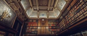 Two-Story Library with Ornate Ceiling